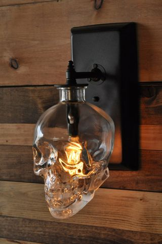 Glass skull wall sconce